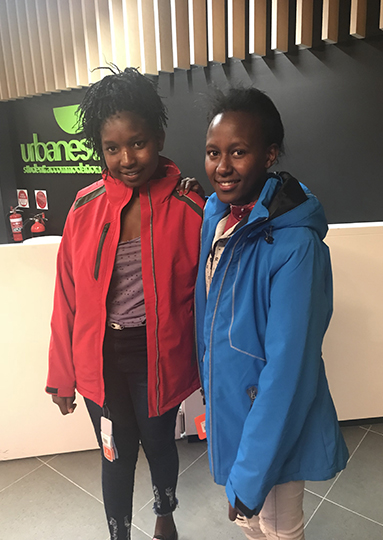 Magdalene and Sharon try on their new winter jackets