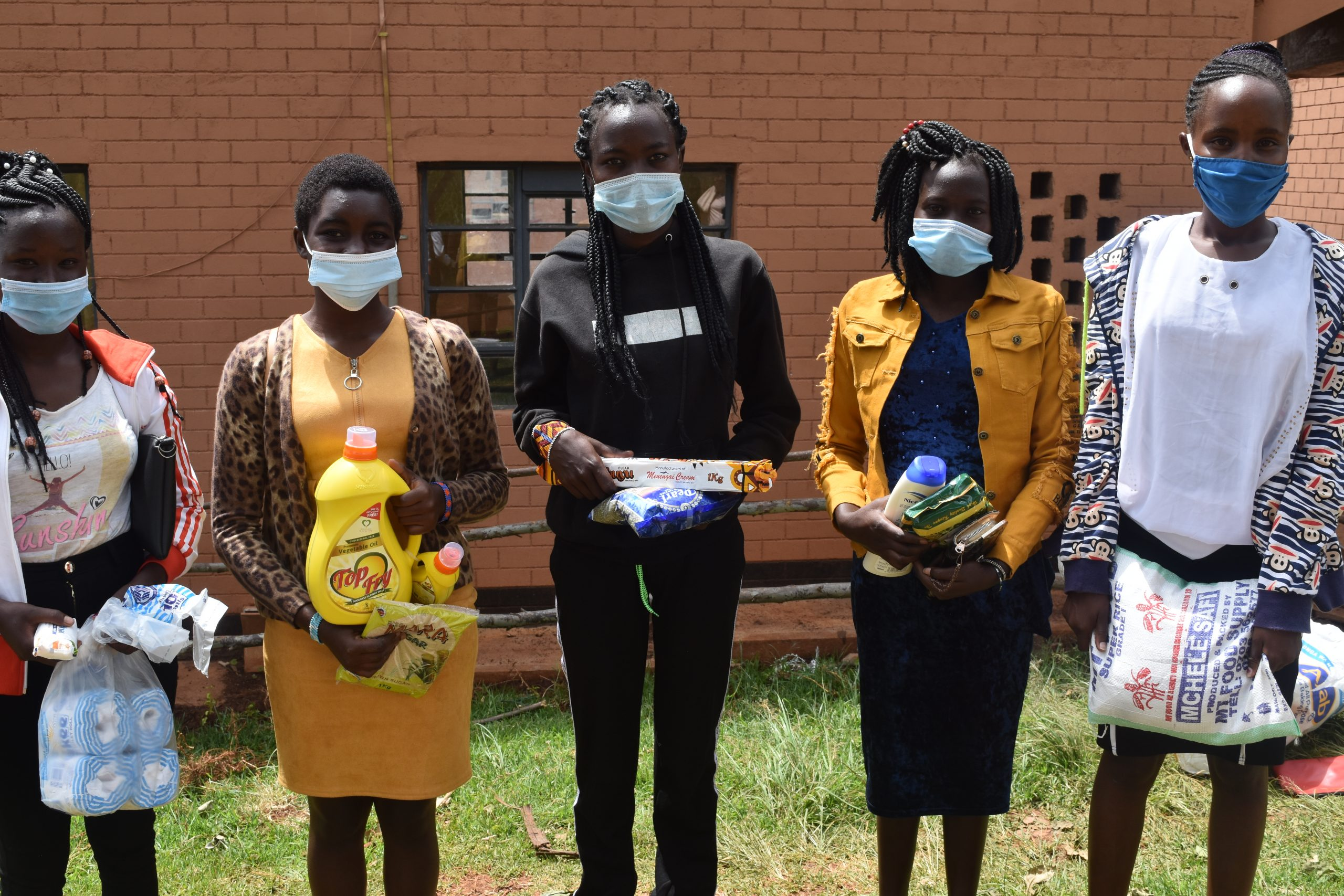 Kenyan girls with supplies provided by Women for Change